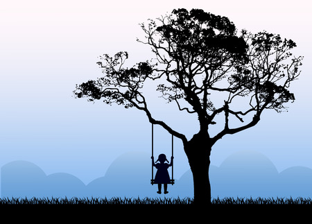 Child silhouette sitting on a swing. Swing hanging from a tree. The tree grows on a meadow next to the mountains