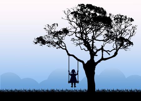 silueta del niño sentado en un columpio. El columpio que cuelga de un árbol. El árbol crece en un prado al lado de las montañas