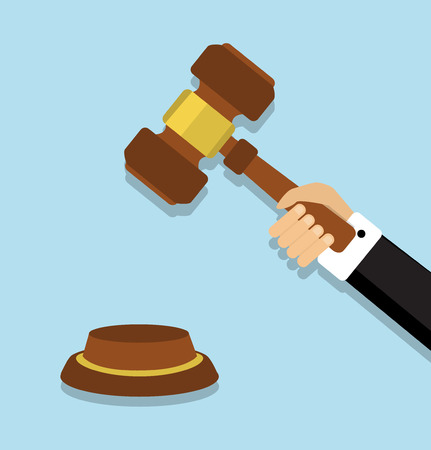 human hand in a suit holding gavel and prepares to strike
