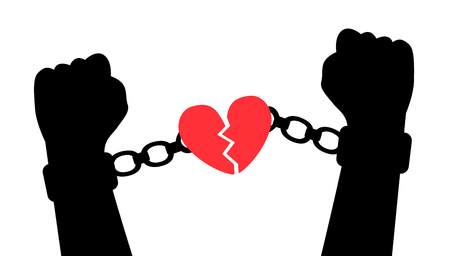 liberation: Hands tear handcuffs with a heart symbolizing love