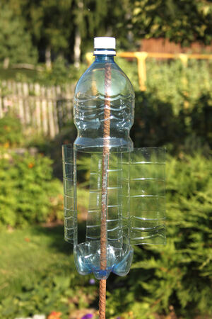 vibrations: A plastic bottle turn by wind and make vibrations in the ground for frightening moles and others rodents