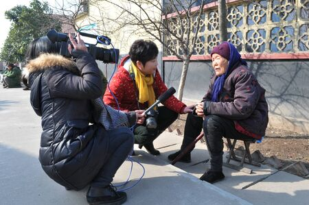 interviewed: Scene of a 97 years old granny being interviewed Editorial