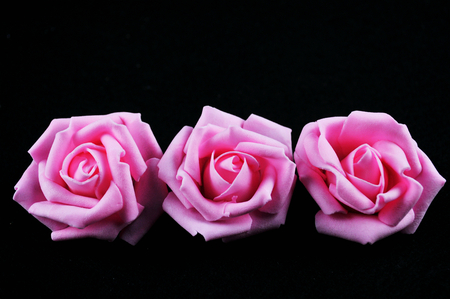 decadence: Three paper flowers Stock Photo