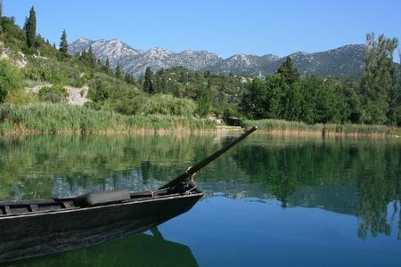 shallop:  Bacinska lake with old boat Stock Photo