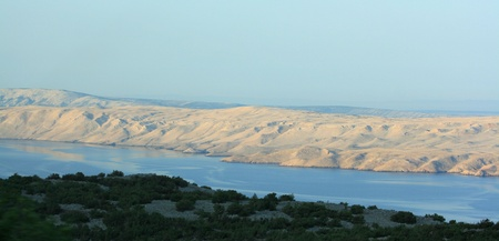 view from mainland at the island Pag, Croatia photo