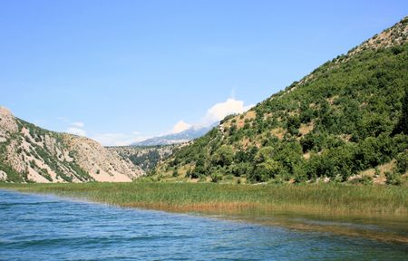 Zrmanja river, sailing towards the sea from Obrovac, Croatia photo