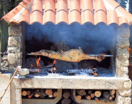 pig on grill, Croatia photo
