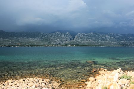 a growing storm above the Velebit mountains in Rovanjska, Croatia photo
