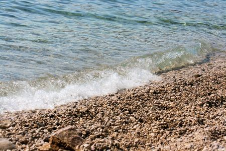pebble beach: wave on a pebble beach