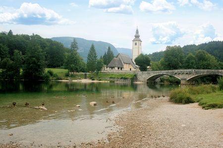 karawanks: view on church, lake Bohinj, Slovenia