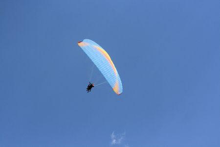 karawanks: paragliding in blue sky