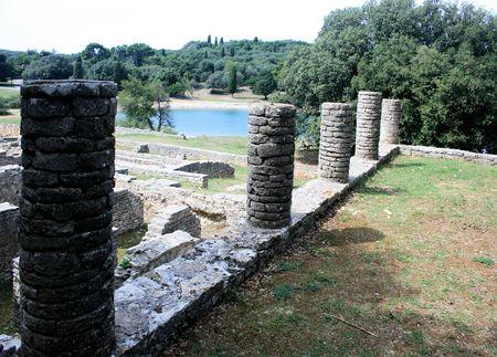 roman empire: remainigs or roman empire and blue sea in national park Brioni, Croatia Stock Photo