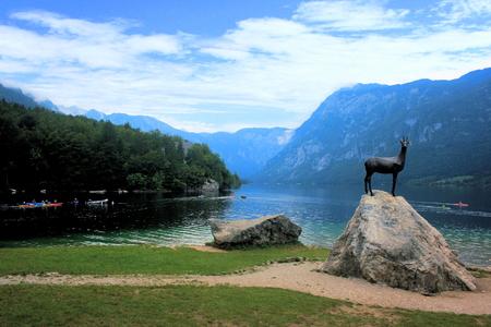 karawanks: view on Lake Bohinj with statue
