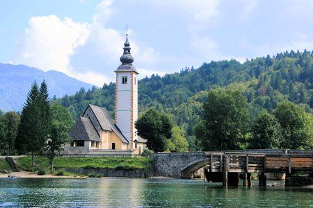 karawanks: view church, Lake Bohinj Stock Photo