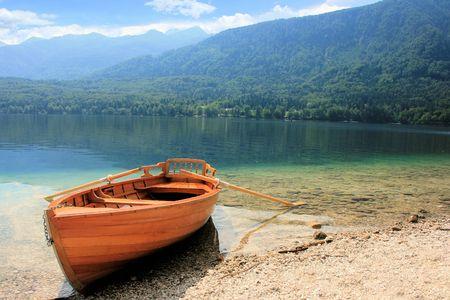 karawanks: rowboat on lake Bohinj, Slovenia Stock Photo