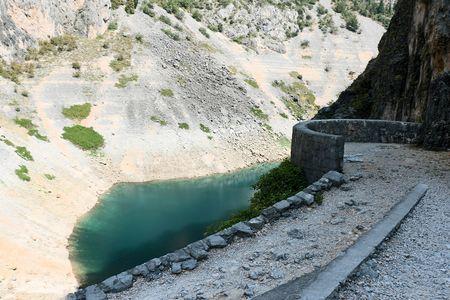 hiking to the blue lake or Imotski in Croatia Stock Photo