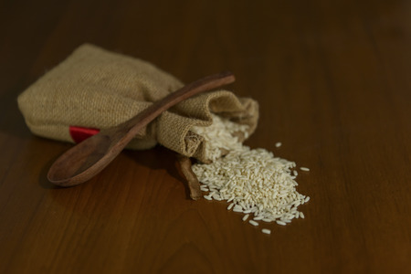 milled: Milled rice in sag with spoon