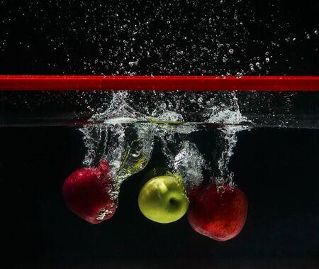drop in: Apple drop in water Stock Photo