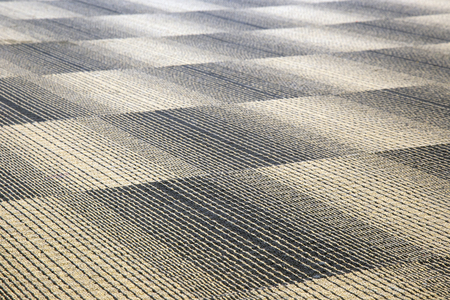 upper floor: A carpet is a textile floor covering consisting of an upper layer of pile attached to a backing. Stock Photo