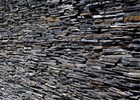 spliced: Slate stone wall background grey stone wall Stock Photo