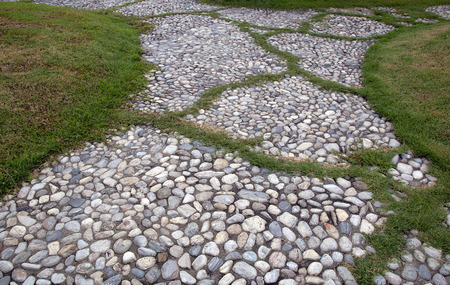 gravel: field green grass with stone gravel path and walkway walk way in the garden