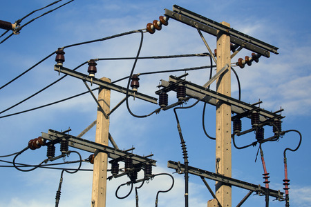 electric grid: electrical post with blue sky background