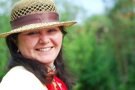 beatitude: Young lady wearing straw hat Stock Photo