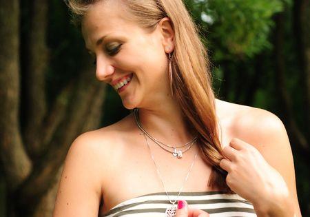 tress: Smiling girl touching tress