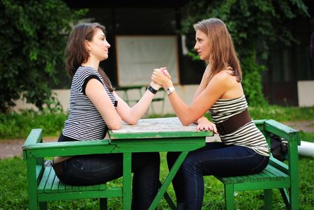 concurrent: Arm wrestling scene