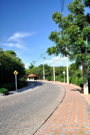 brick curve road in koh lahn, thailand photo