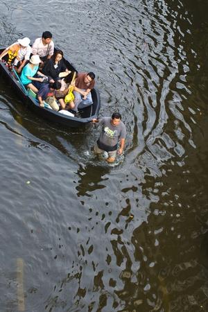 BANGKOK, THAILAND-NOVEMBER 8: People are using boats and rafts as a transportation through water during the worst flooding in decades on November 8, 2011 Ngam Wong Wan Road, bangkok, Thailand. Editorial