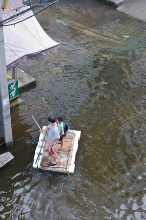 BANGKOK, THAILAND-NOVEMBER 8: People are using boats and rafts as a transportation through water during the worst flooding in decades on November 8, 2011 Ngam Wong Wan Road, bangkok, Thailand.