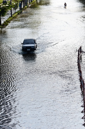 BANGKOK, THAILAND-NOVEMBER 12: Transportation of people in the streets flooded after the heaviest monsoon rain in 20 years in the capital on  November 12, 2011 Phahon Yothin Road, bangkok, Thailand.