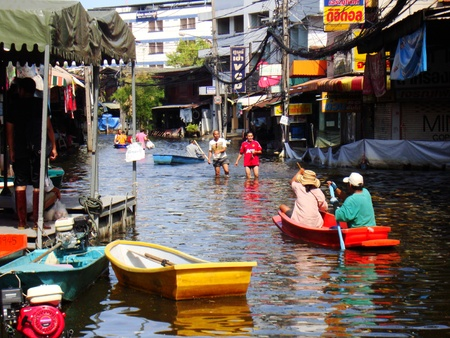 BANGKOK, THAILAND-NOVEMBER 27: People are using boats and rafts as a transportation through water during the worst flooding in decades on November 27, 2011, Ram Inthra 39, Ram Inthra Road, bangkok, Thailand.