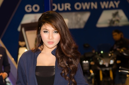 BANGKOK, THAILAND - DECEMBER 6: Unidentified female presenter at Triumph booth in THE 28th THAILAND INTERNATIONAL MOTOR EXPO 2011 on DeCember 6, 2011 in Bangkok, Thailand.