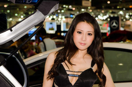 BANGKOK, THAILAND - DECEMBER 6: Unidentified female presenter at Alpine booth in THE 28th THAILAND INTERNATIONAL MOTOR EXPO 2011 on December 6, 2011 in Bangkok, Thailand. Editorial