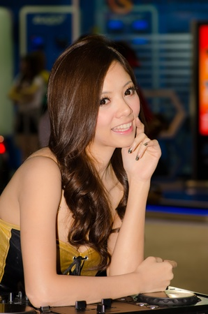 BANGKOK, THAILAND - DECEMBER 6: Unidentified female presenter at Pioneer booth in THE 28th THAILAND INTERNATIONAL MOTOR EXPO 2011 on December 6, 2011 in Bangkok, Thailand.