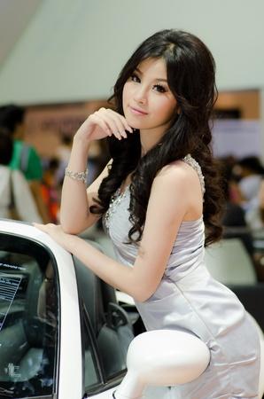 BANGKOK, THAILAND - DECEMBER 6: Unidentified female presenter at Mazda booth in THE 28th THAILAND INTERNATIONAL MOTOR EXPO 2011 on December 6, 2011 in Bangkok, Thailand.