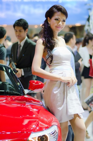 BANGKOK, THAILAND - DECEMBER 6: Unidentified female presenter at BMW booth in THE 28th THAILAND INTERNATIONAL MOTOR EXPO 2011 on December 6, 2011 in Bangkok, Thailand.