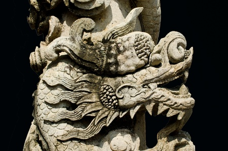 stone dragon in chinese style isolated on black background photo