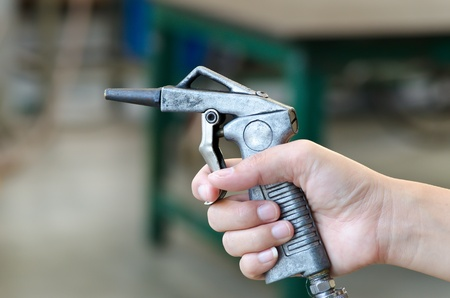 air nozzles gun in hand photo