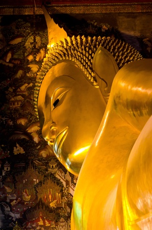 The Big golden Reclining Buddha within Wat Pho is the important in Bangkok, Thailand