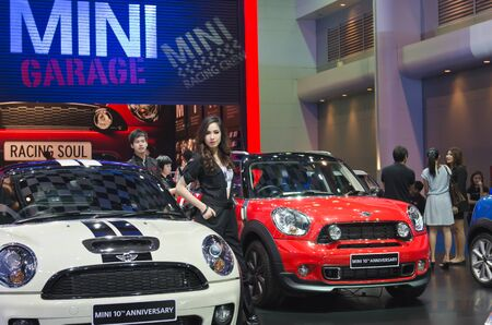 BANGKOK - MARCH 31: Mini cooper car with unidentified model on display at The 33th Bangkok International Motor Show on March 31, 2012 in Bangkok, Thailand. Editorial