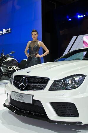 BANGKOK - MARCH 31:Benz AMG car with unidentified model on display at The 33th Bangkok International Motor Show on March 31, 2012 in Bangkok, Thailand.