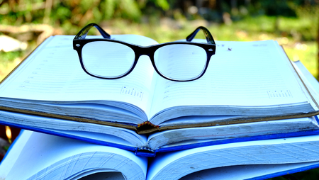 glasses on big book,Education themes Stock Photo