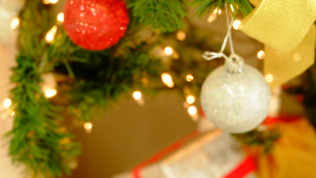 New Years and Christmas themes.Beautiful light tree decorated.blured background.