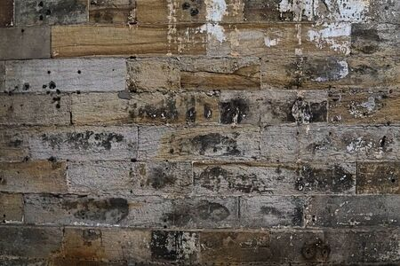 Grain Image of brick stone wall background in detail and texture pattern. Dirty brick wall with peeling paint in abandon factory Stock Photo