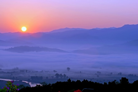 Sunset on field and mountain at country Cheangmai Thailand. photo
