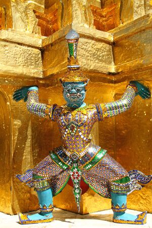 Statue giant in story Ramayana. At Wat Phra Kaew the Grand Palace in Bangkok, Thailand  photo