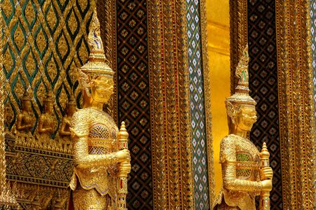 gaurd: Two guard giant in the door at Wat Phra Kaew in Bangkok, Thailand.
